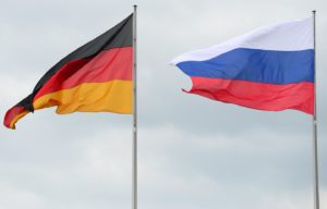 National flags of Germany (L) and Russian Federation (R) are displayed in front of the Chancellery in Berlin on June 1, 2012, where Russian President is to visit German chancellor for his first trip to Germany since returning as leader of Russia. The main topic of the meeting of Vladimir Putin and Angela Merkel will be the unrest in Syria, as Western powers attempt to persuade the Kremlin to drop its support for the regime of Bashir al-Assad. AFP PHOTO / JOHN MACDOUGALL (Photo credit should read JOHN MACDOUGALL/AFP/GettyImages)