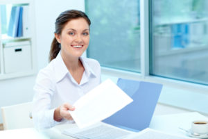 Portrait of happy employer giving test results to applicant