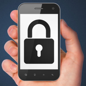 Security concept: hand holding smartphone with Closed Padlock on display. Generic mobile smart phone in hand on Dark Blue background.